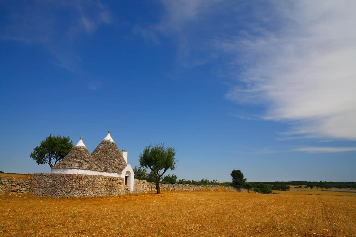 Beautiful Apulia countryside with typical trulli farm house, Italy